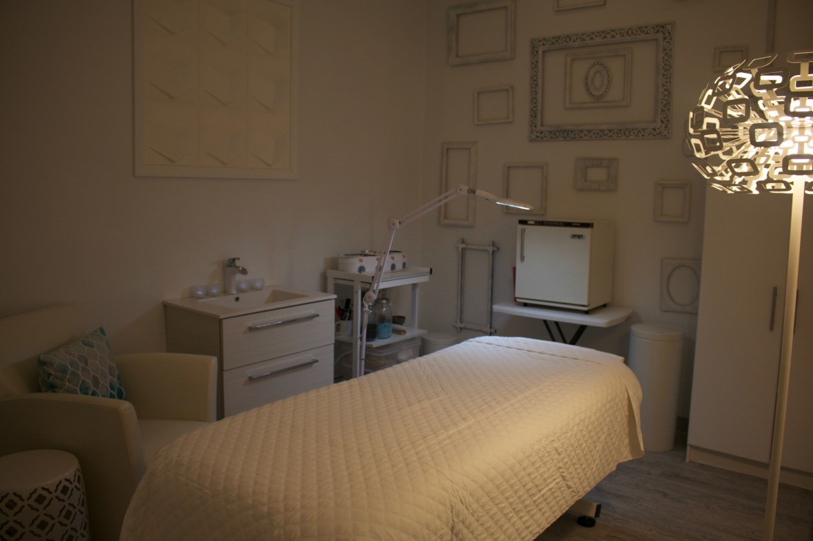 White massage table in room at Heather Brown Face and Body Studio